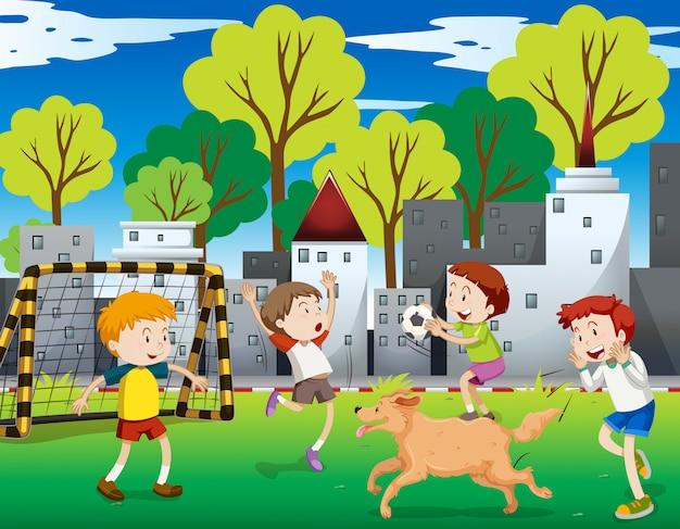 Crianças urbanas jogando futebol