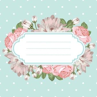 Crisântemos e rosas chiques gastos no fundo do às bolinhas com quadro vazio, vazio.