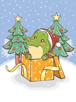 Crocodilo fofo com caixa de presente e árvore de natal - ilustração de personagem de desenho animado