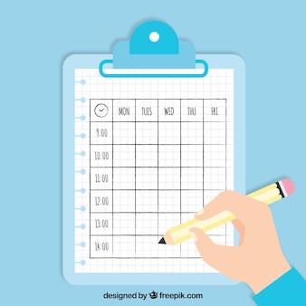 Cronograma escolar na prancheta e mão com lápis