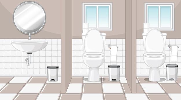 Cubículos de banheiro público com pia e espelho