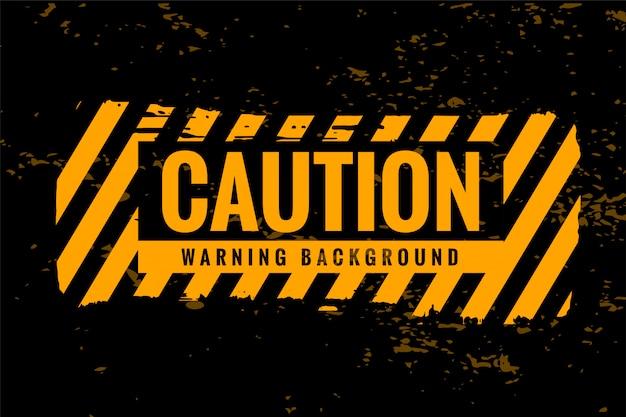 Cuidado aviso fundo com listras amarelas e pretas