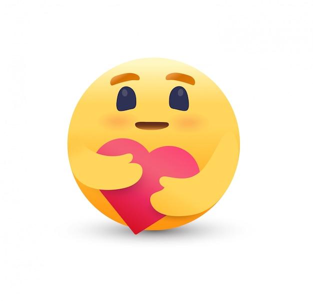 Cuidado emoji abraçando um coração vermelho.