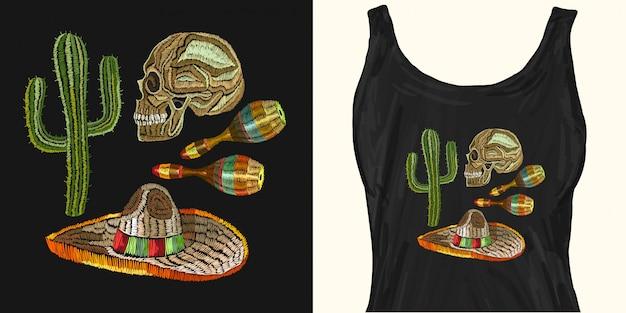 Cultura mexicana de bordado. crânio humano, sombrero, maracas, cacto
