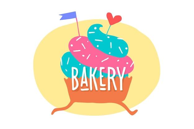 Cupcake com coração e texto padaria.