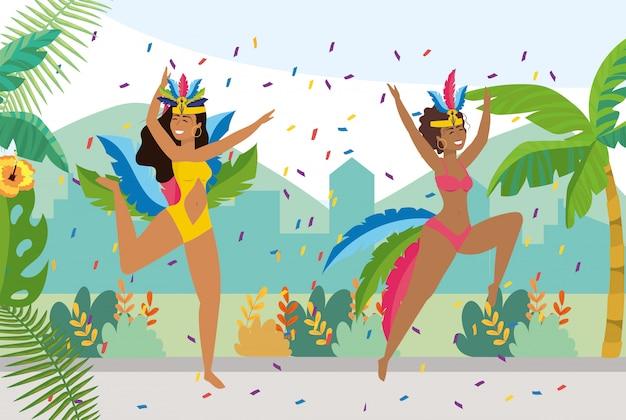 Dançarinas de meninas com decoração de traje e confete