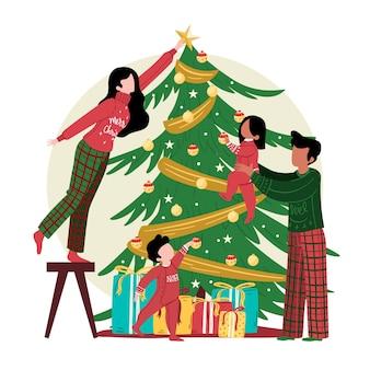 Decoração da árvore de natal com a família