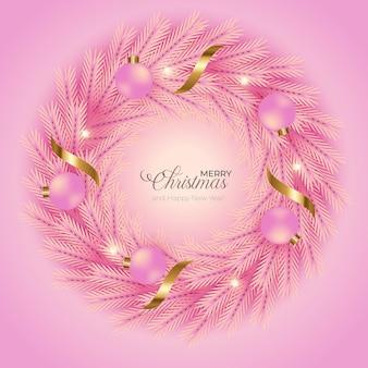 Decoração de guirlanda de natal com fundo rosa ramo de pinheiro rosa e bola de natal