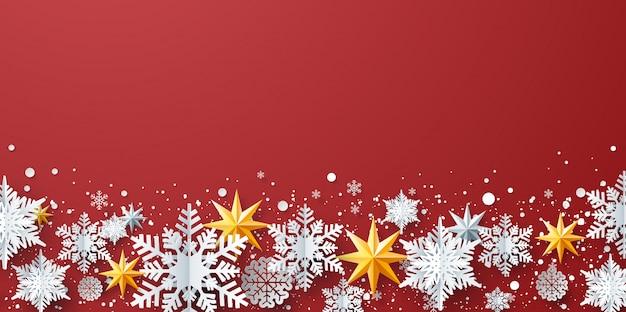 Decoração de inverno com flocos de neve, estrelas no fundo vermelho