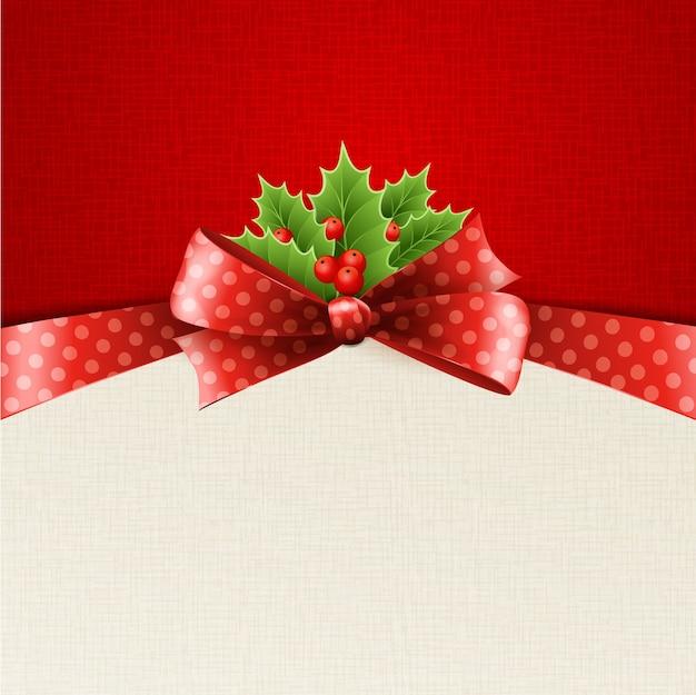 Decoração de natal com folhas de azevinho, laço