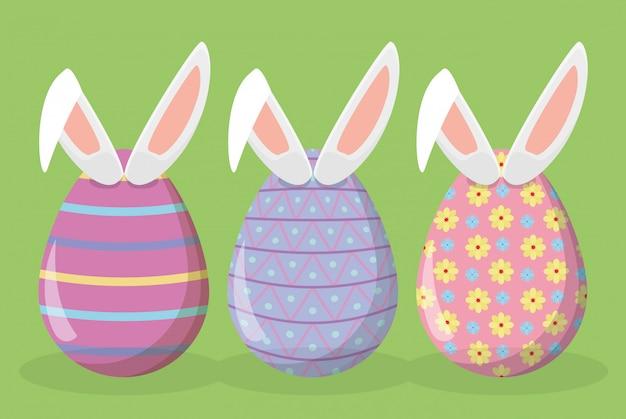 Decoração de ovos de páscoa feliz com orelhas de coelho