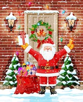 Decoração de porta de natal com papai noel e árvores