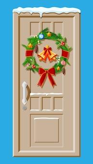 Decoração de porta de natal isolada em azul