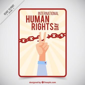 Dedos que cortam uma cadeia para o dia dos direitos humanos