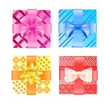 Definir caixas de presente embrulhado coloridas com arcos conceito de celebração do dia dos namorados
