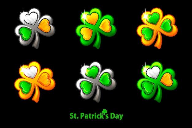 Definir o trevo precioso para o dia do st. patricks em um fundo preto. símbolos de trevo de joias dourados e prateados.