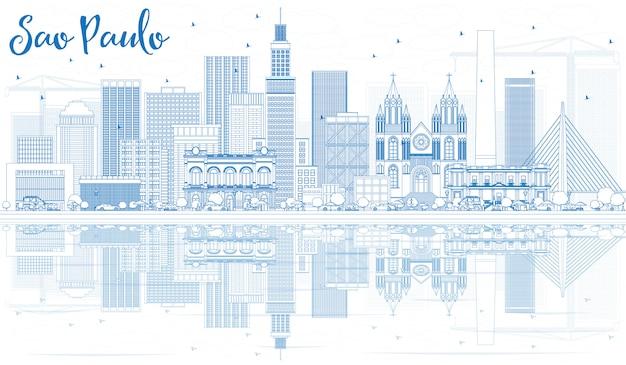 Delinear o horizonte de são paulo com prédios azuis e reflexões.