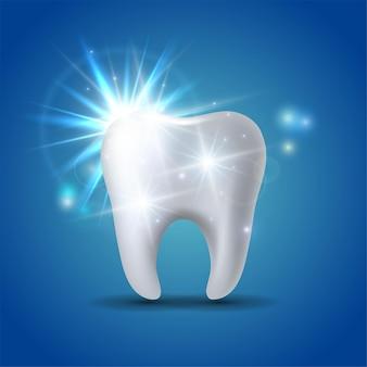 Dente branco brilhante isolado no azul