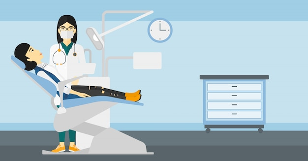 Dentista e mulher na cadeira do dentista.