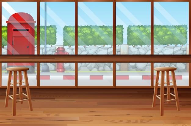Dentro do restaurante com bar e cadeiras