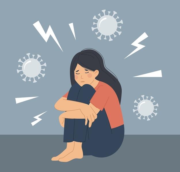 Depressão, ansiedade por causa da pandemia do coronavírus. uma mulher se senta no chão e abraça os joelhos