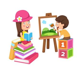 Descanso e passatempo das crianças pintando e lendo livro