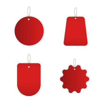 Desconto e etiquetas de preço em papel vermelho, em branco. Vetor Premium
