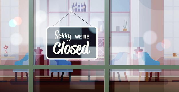 Desculpe, estamos fechados sinal pendurado fora da janela do café coronavírus pandemia quarentena