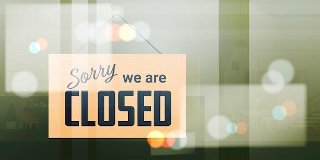 Desculpe, estamos fechados sinal pendurado fora do escritório de negócios loja loja ou restaurante