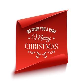 Desejamos a você um feliz natal, modelo de cartão de saudação. bandeira vermelha, curva, de papel isolada no fundo branco.