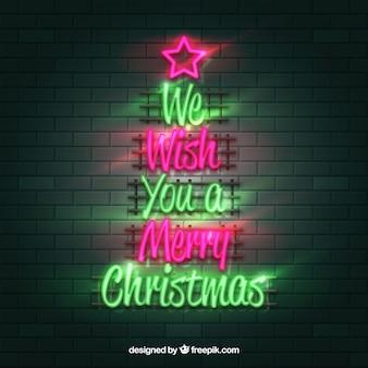Desejamos-lhe um feliz natal escrito em néon verde e rosa