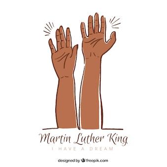 Desenhada à mão martin luther king fundo dia com duas mãos