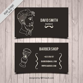 Desenhada homem mão e escova cartão de barbeiro