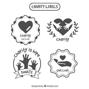 Desenhadas mão etiquetas de caridade decorativos