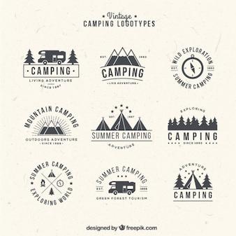 Desenhadas mão logos de campismo no estilo do vintage