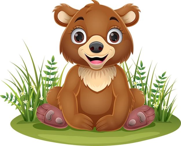 Desenho animado bebê urso pardo sentado na grama