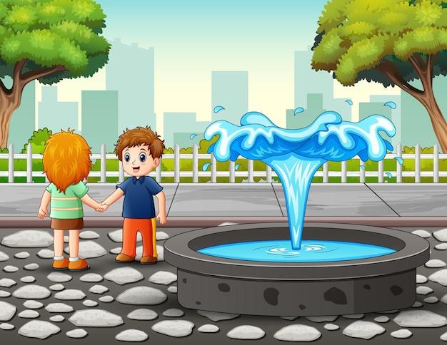Desenho animado de duas crianças apertando as mãos perto da fonte