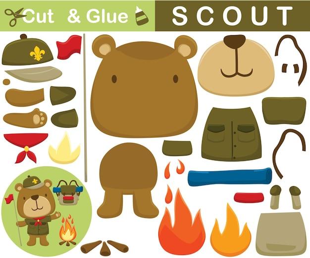 Desenho animado de urso engraçado o escoteiro com fogueira e mochila. jogo de papel de educação para crianças. recorte e colagem
