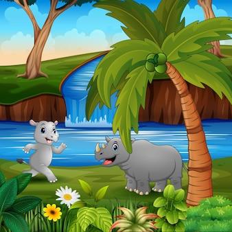 Desenho animado dos rinocerontes brincando à beira do rio