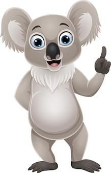 Desenho animado pequeno coala apontando para cima