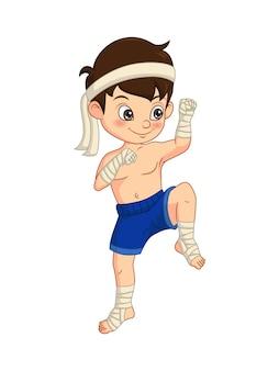 Desenho animado pequeno lutador de muay thai engraçado Vetor Premium