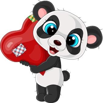 Desenho animado pequeno panda segurando um coração vermelho