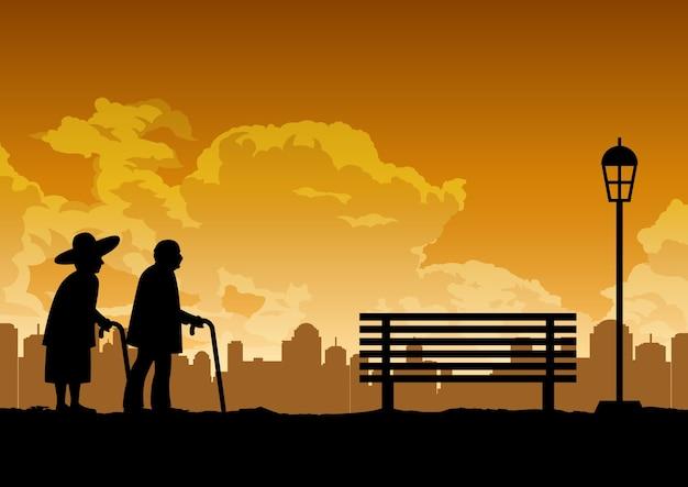 Desenho da silhueta de dois velhos casal caminhando no pak