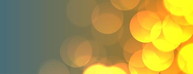 Desenho de banner com luzes amarelas brilhantes bokeh