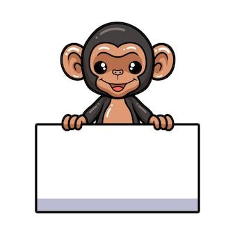 Desenho de chimpanzé bebê fofo com sinal em branco