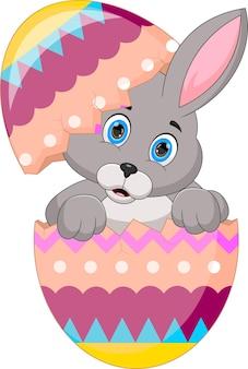 Desenho de coelho fofo dentro de um ovo de páscoa
