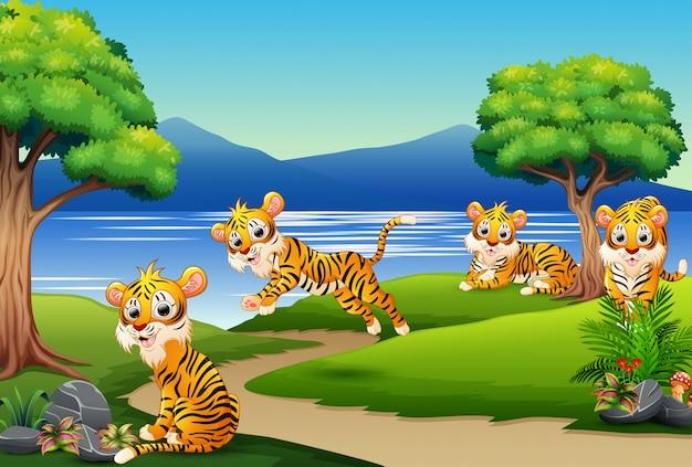 Desenho de grupo feliz tigre na cena da natureza