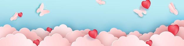 Desenho de papel cortado, nuvens de papel com borboletas. nuvem rosa, corações vermelhos, fundo azul.