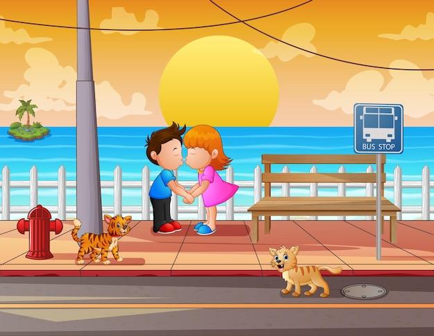Desenho de um casal se beijando com vista para a praia