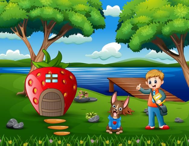 Desenho de um menino de escola com seu animal de estimação perto da casa de morango